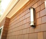 New cedar shake exterior skin and exterior lighting.